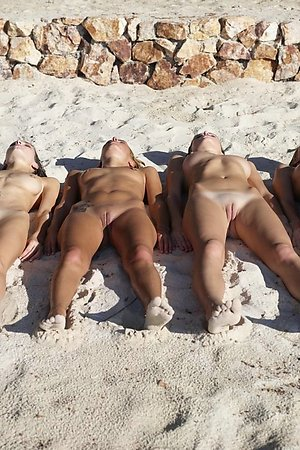beautiful young female nudists loves to push the legs at florida nude beaches