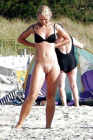 beautiful nudist girlfriend sunbathes without bikini by the sea