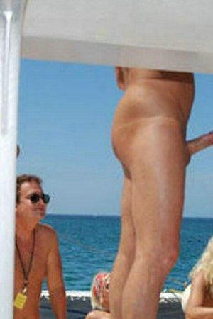 Nudist girls at beach stimulates their boys for erection
