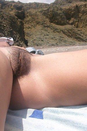 Spread leg on beach photos - too hot!