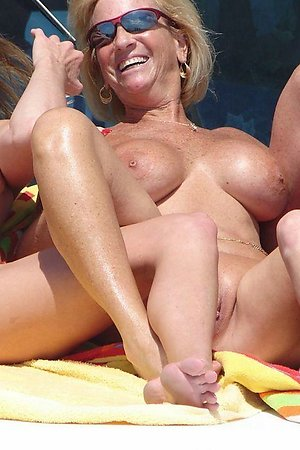 Close-up and spread legs from nude beach