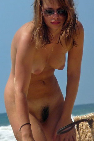 Nudists girl relax at beach