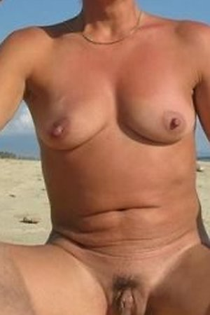 Nudist women likes to spread their legs on beach