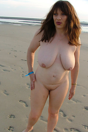 Nudist plumpers of 30-50 y.o. sunbathig on a beach