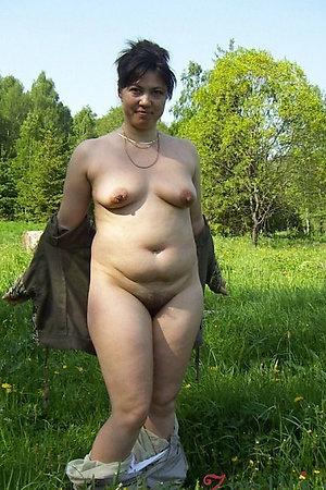 Mature women undressing for naturist time