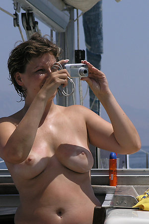 Nude mature women on their nudist boat