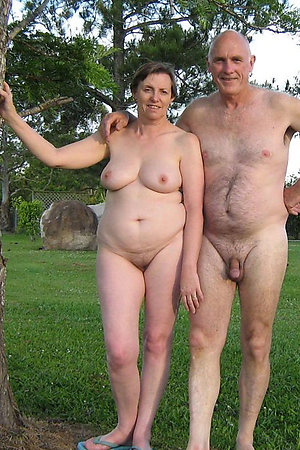 Pretty mature nudists posing outdoors