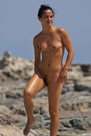 A busty bikini babe undressing on the Baker