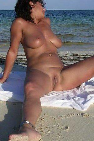 A busty bikini slut undressing on the Waikiki