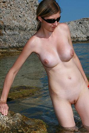 A bikini lady going topless on the La Joya Nude