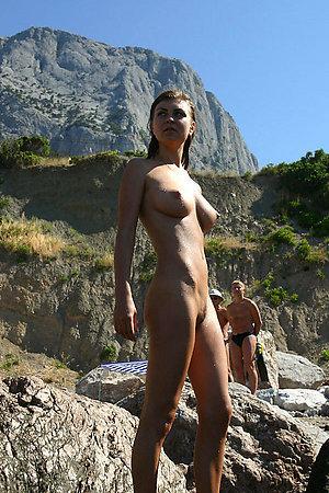 A girl stripping out of her bikini on the Rarawa Nudist