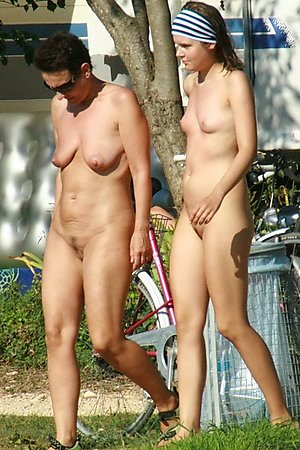 well-built blonds and brunet girls fully exposed at beach