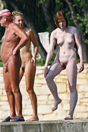 Sexy nudist girls spreads legs on the beach