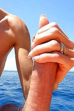 Sexy babe sucks huge dick on a beach