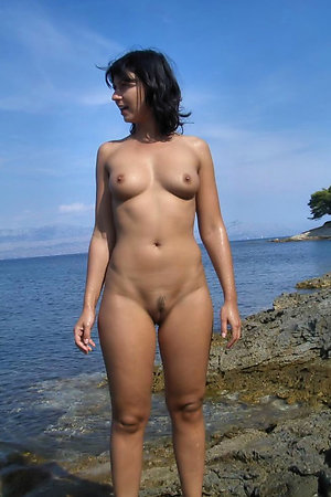 Nudist girls likes to show their shaved pussy at nude beach
