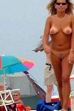 Lovely girls bare their bodies on the beach