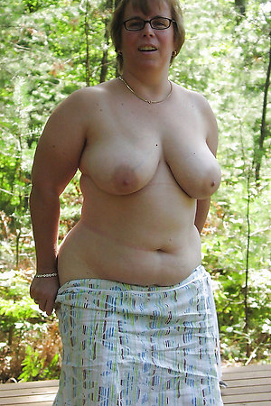 Older women shy to undress outdoors