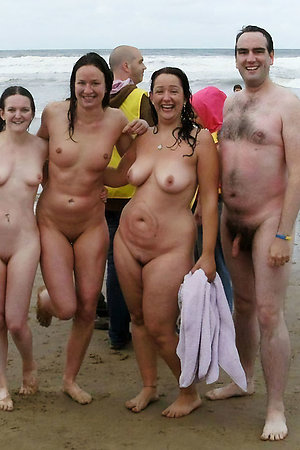 Nudist people with age difference posing together