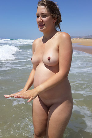 Nudist preggos ready for swimming nude in the sea