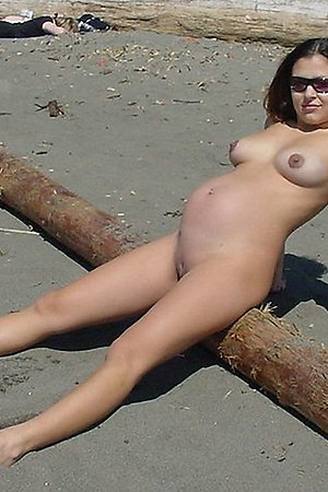 Pregnant nudist girls undressing on nude beach
