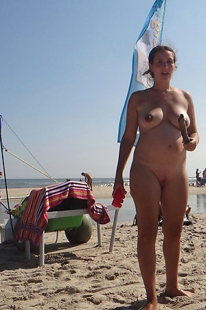 Amateur pregnant housewife on nudist beach