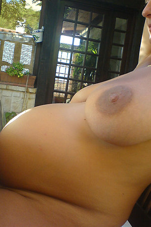 Pregnant naturist wives showing their big bellies