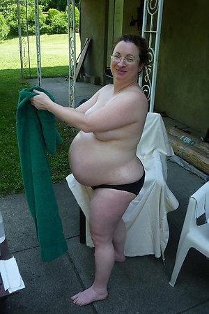 Nudist pregnant women posing for camera