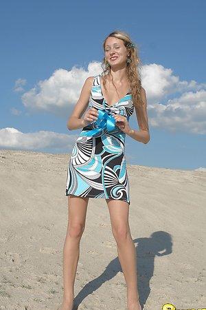 Blonde girl next door undressing and posing nude in the sun