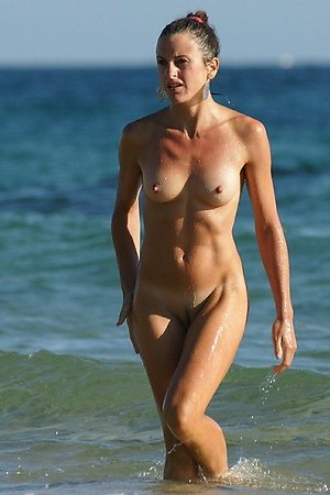 a lot of nudist photos, shaved  pussy, hidden beach shot at at nudist beach
